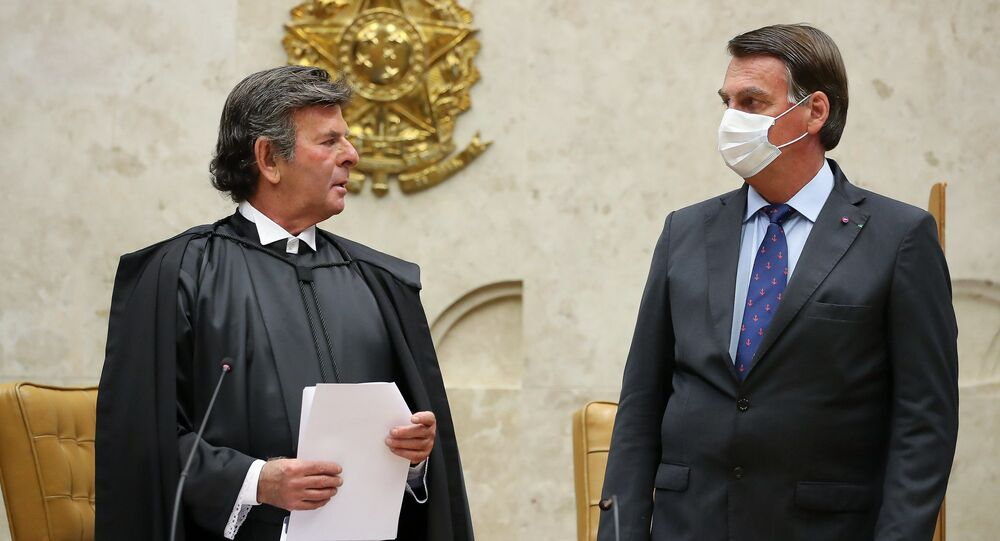 Presidente Jair Bolsonaro e ministro Luiz Fux se olham no Supremo Tribunal Federal, em 10 de setembro de 2020