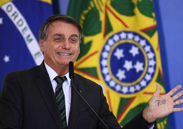 Presidente do Brasil, Jair Bolsonaro, durante lançamento da iniciativa Adote um Parque, no Palácio do Planalto, Brasília, 9 de fevereiro de 2021