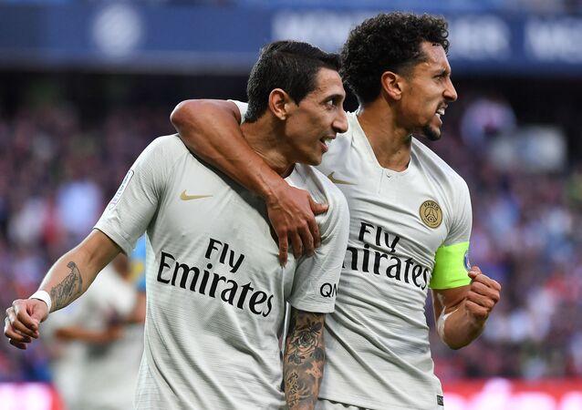 O zagueiro brasileiro Marquinhos e o meia argentino Ángel Di María durante jogo do seu clube, o Paris Saint-Germain (PSG), contra o Montpellier, pelo campeonato francês, no Stade de la Mosson, em Montpellier, sul da França, em 30 de abril de 2019