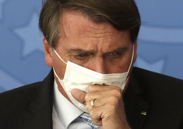 Presidente Jair Bolsonaro durante cerimônia no Palácio do Planalto para assinar lei que facilita compra de vacinas