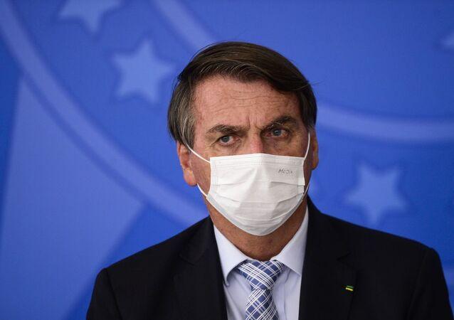 O presidente Jair Bolsonaro durante cerimônia para sanção dos projetos de lei que ampliam a aquisição de vacinas pelo governo federal, em 10 de março de 2021