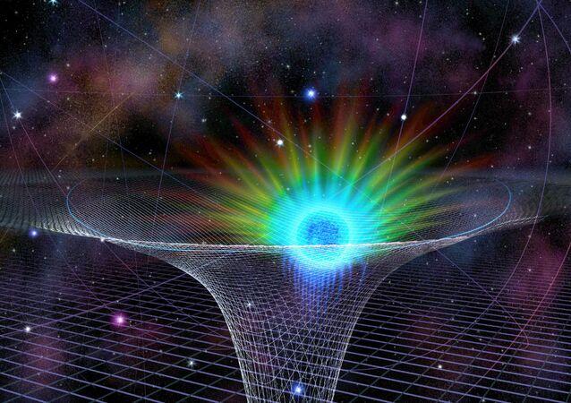 Representação gráfica da estrela S0-2 (o objeto azul e verde representado na imagem) durante aproximação para o buraco negro supermassivo no centro da Via Láctea