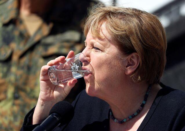 Chanceler alemã Angela Merkel durante coletiva de imprensa no povoado de Schuld, devastado pelas inundações na Alemanha, 18 de julho de 2021