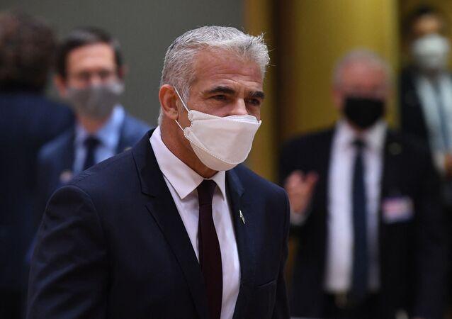 Ministro das Relações Exteriores de Israel, Yair Lapid, chega para uma reunião do Conselho de Relações Exteriores na sede da UE em Bruxelas em 12 de julho de 2021