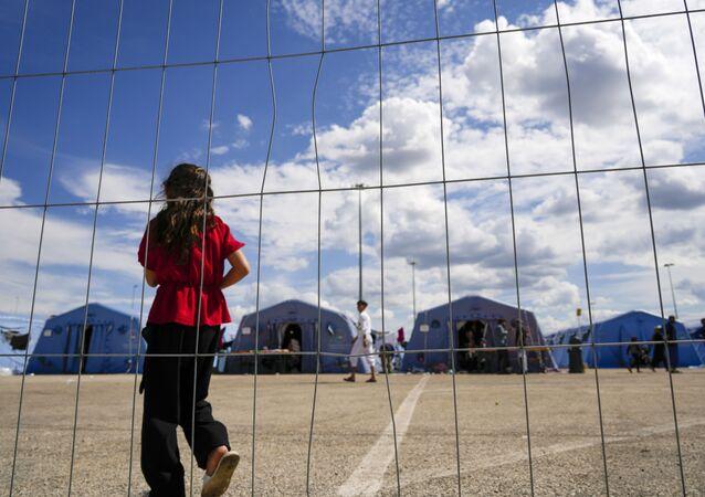 Afegãos no campo de refugiados em Avezzano, Itália, 31 de agosto de 2021