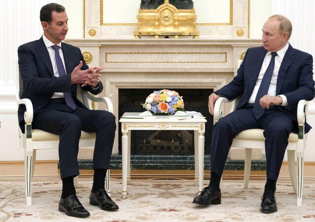 Presidente da Rússia, Vladimir Putin, e o presidente da Síria, Bashar al-Assad, no Kremlin, Moscou, em 13 de setembro de 2021