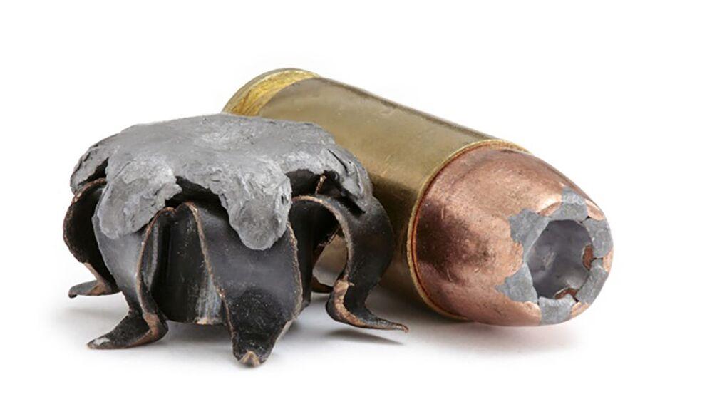 Projétil de ponta côncava utilizado .40 S&W (JHP) com um cartucho do mesmo calibre em fundo