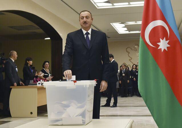 Azerbaijan's President Aliyev casts his ballot at polling station during parliamentary election in Baku