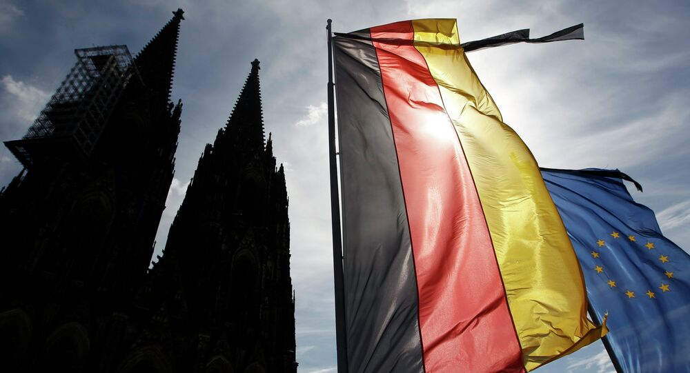 Flags of Germany and the EU fly with black ribbons during a memorial service for the 150 victims of Germanwings flight 4U 9525 in Cologne's Cathedral, April 17, 2015