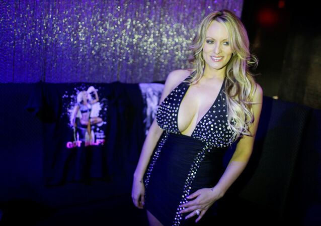 Adult-film actress Stephanie Clifford, also known as Stormy Daniels, poses for pictures at the end of her striptease show in Gossip Gentleman club in Long Island, New York, U.S., February 23, 2018.