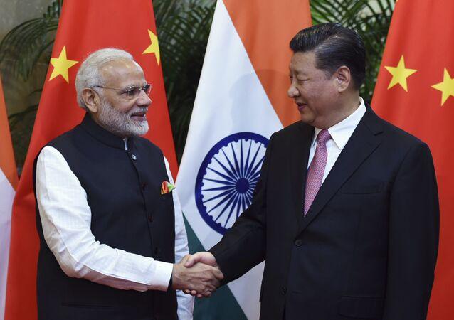 Narendra Modi, primeiro-ministro da Índia, e Xi Jinping, presidente da China, durante encontro informal em Wuhan, na China.