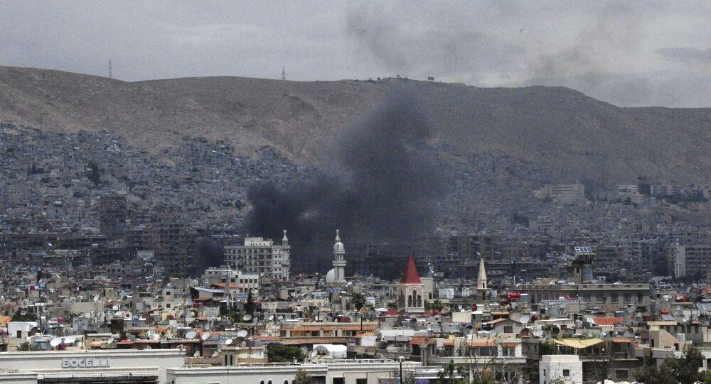 Damasco após bombardeamentos, supostamente por terroristas do Daesh