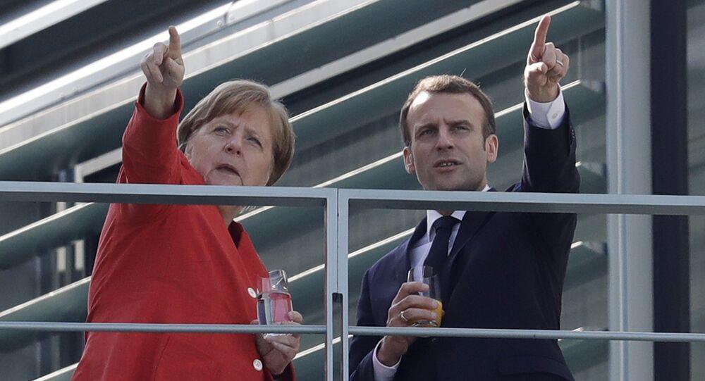 Angela Merkel e Emmanuel Macron.