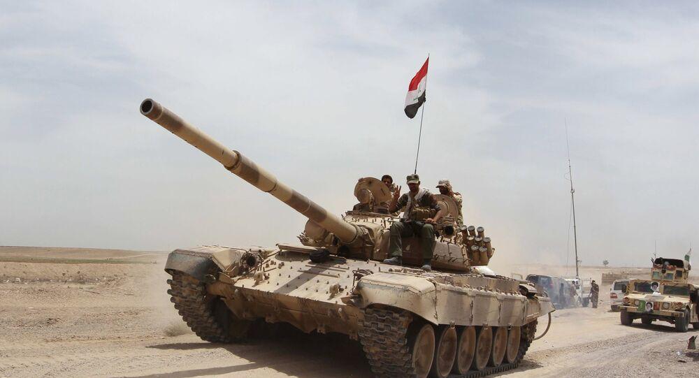 Os militares iraquianos e as milícias xiitas tentam retomar Ramadi das mãos do Estado Islâmico.