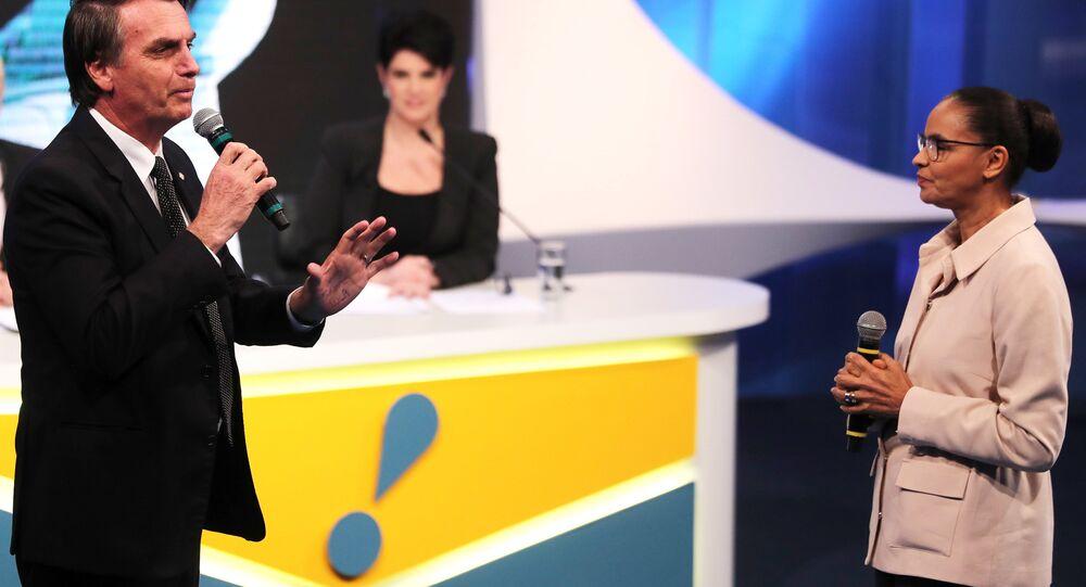 Jair Bolsonaro e Marina Silva durante debate presidencial da RedeTV (arquivo)