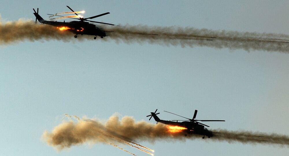 Helicópteros de ataque Caçador Noturno durante ensaios antes da inauguração do fórum EXÉRCITO 2018