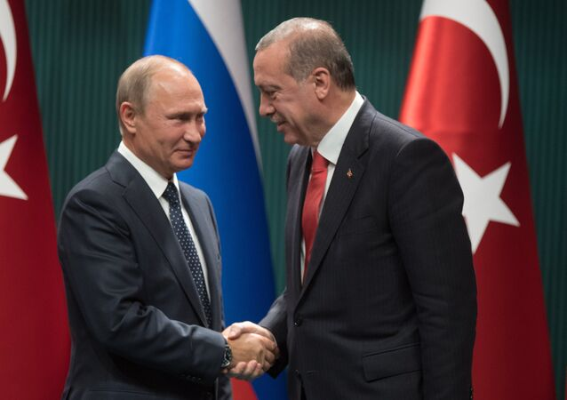 Russian President Vladimir Putin and Turkish President Recep Tayyip Erdogan, right, at a news conference following the Russian-Turkish talks in Ankara