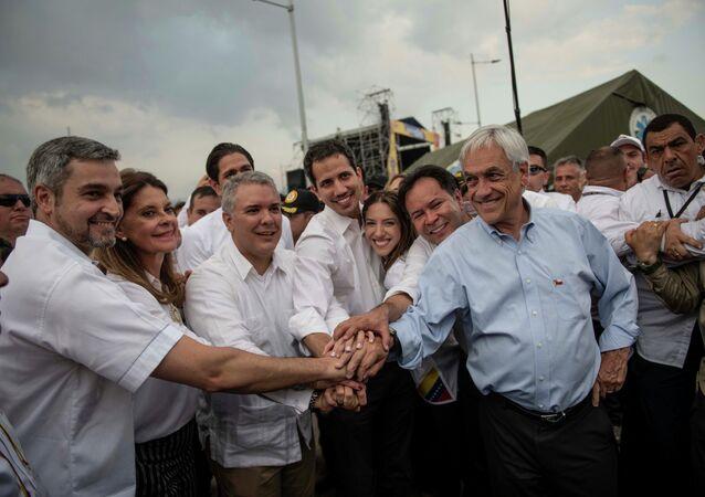 O presidente do Chile, Sebastián Piñera, o líder da oposição venezuelana Juan Guaidó, o presidente da Colômbia, Ivan Duque e o presidente do Paraguai, Mario Abdo Benitez, participam do concerto Venezuela Live Aid na fronteira entre Colômbia e Venezuela, na cidade de Cucuta.
