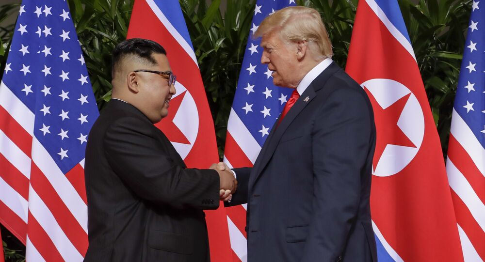U.S. President Donald Trump shakes hands with North Korea leader Kim Jong Un at the Capella resort on Sentosa Island Tuesday, June 12, 2018 in Singapore.