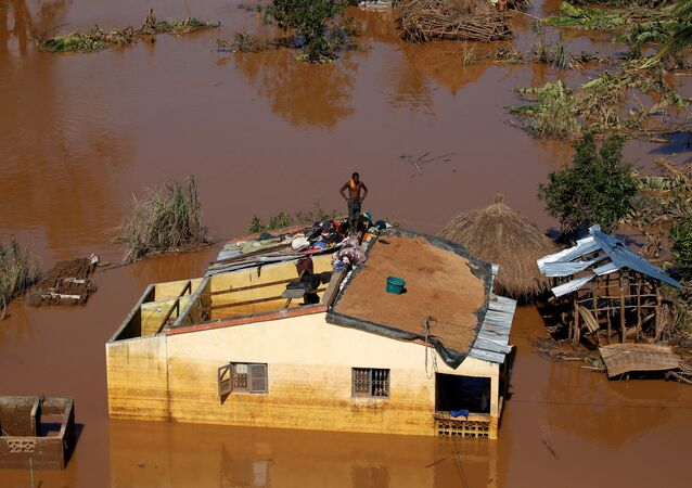 A man looks on atop his house after Cyclone Idai in Buzi district outside Beira, Mozambique, March 22, 2019.