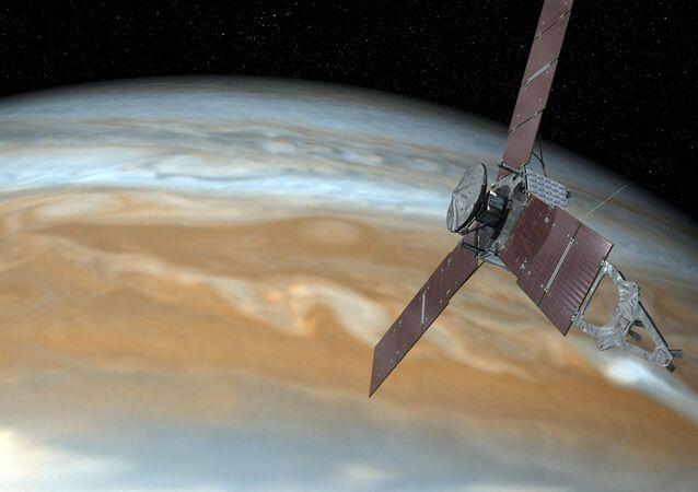 Imagem artística mostra nave espacial Juno da NASA voando perto de Júpiter, 19 de outubro de 2016