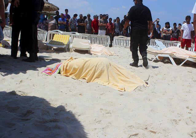 The body of a tourist shot dead by a gunman lies near a beachside hotel in Sousse, Tunisia June 26, 2015