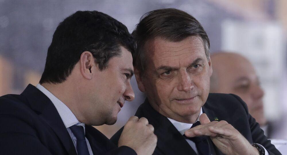 O então ministro da Justiça, Sergio Moro, e o presidente Jair Bolsonaro durante evento em Brasília em 9 de agosto de 2019, quando ainda tinham bom relacionamento e forte aliança