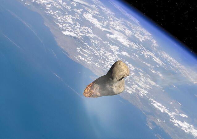 Un asteroid pasa cerca de la atmósfera de la Tierra (gráfica)