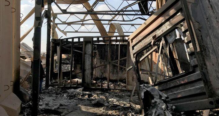 Escombros são vistos no local onde míssil iraniano atingiu a base aérea de Ain Al-Asad, na província de Anbar, Iraque, no dia 13 de janeiro de 2020