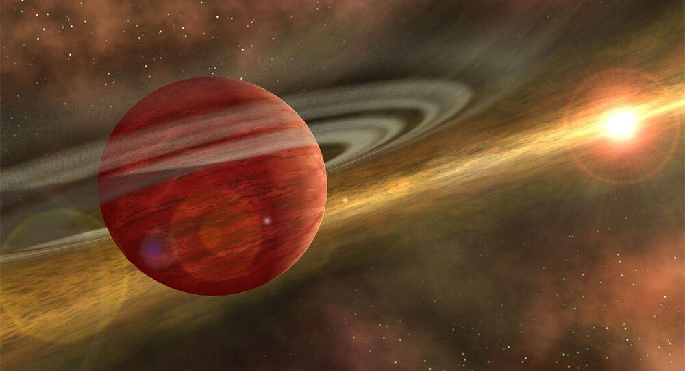 Imagem artística de um planeta maciço orbitando uma estrela jovem e fria
