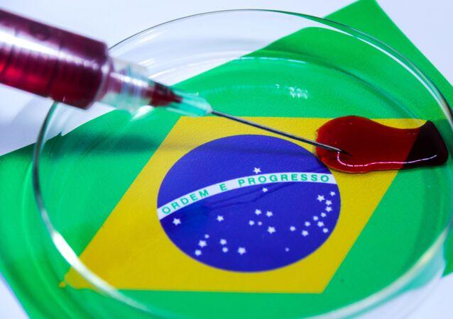 Imagem ilustrativa do COVID-19 (novo coronavírus) com a bandeira do Brasil