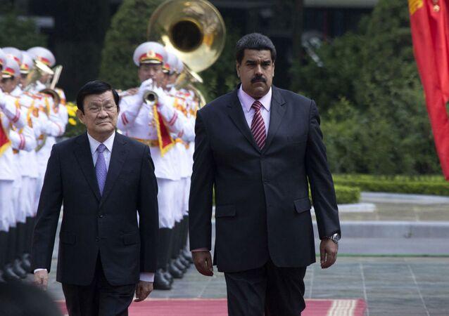 Truong Tan Sang e Nicolás Maduro, respectivamente presidentes do Vietnã e da Venezuela.