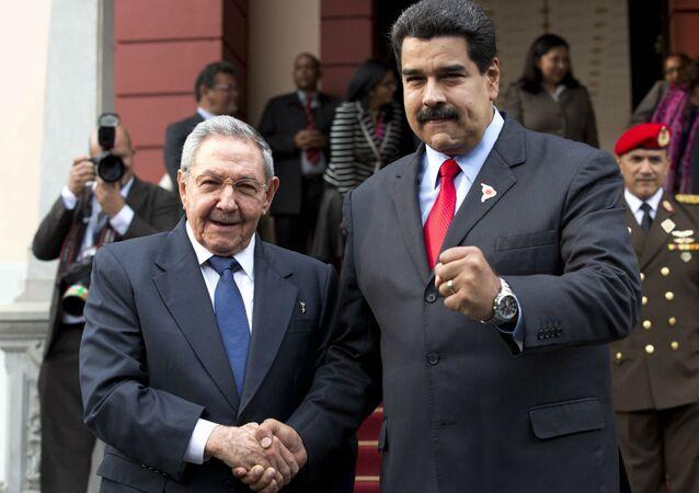 Raúl Castro e Nicolás Maduro.