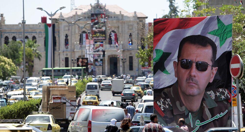 Retrato do presidente sírio, Bashar Assad, nas ruas de Damasco, Síria, em junho de 2014