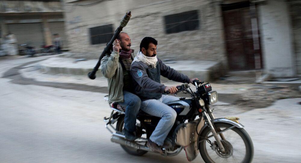 Apoiadores do Exército Livre da Síria em Kafar Taharim, Síria