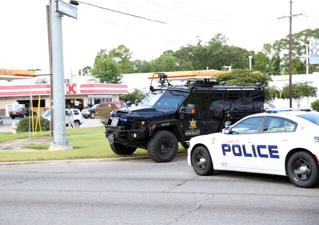 Police officers block off a road after a shooting of police in Baton Rouge, Louisiana, U.S. July 17, 2016.