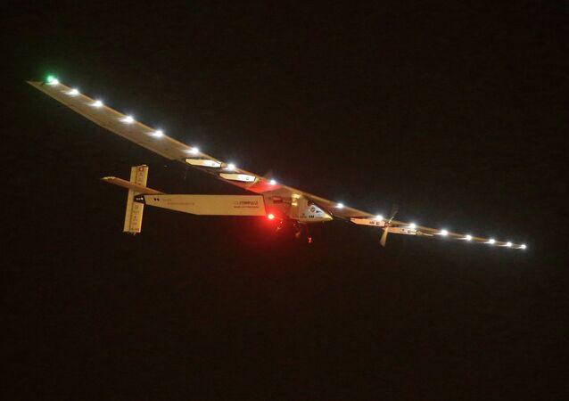 Solar Impulse 2 is seen prior landing at the Nanjing Lukou International Airport in Nanjing, east China's Jiangsu province, on April 21, 2015