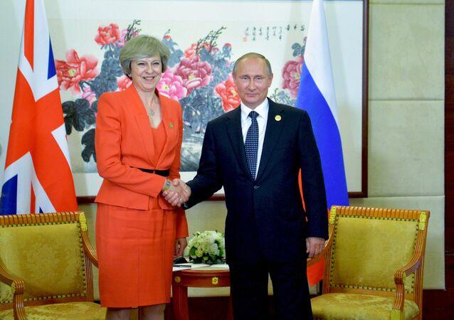 O presidente russo e a premier britânica durante encontro no G20, na cidade chinesa de Hangzhou