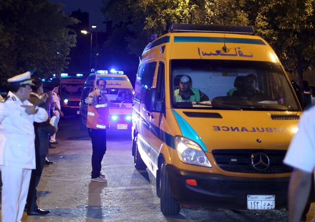 Police open the way for ambulances carrying the bodies of passengers of Airbus-312 to a morgue in Cairo