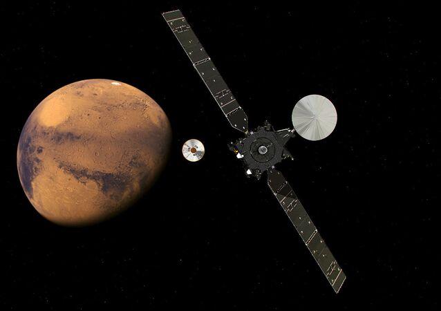 Satélite científico TGO e seu módulo de entrada, descida e aterrissagem Schiaparelli, do programa ExoMars, se aproximando de Marte