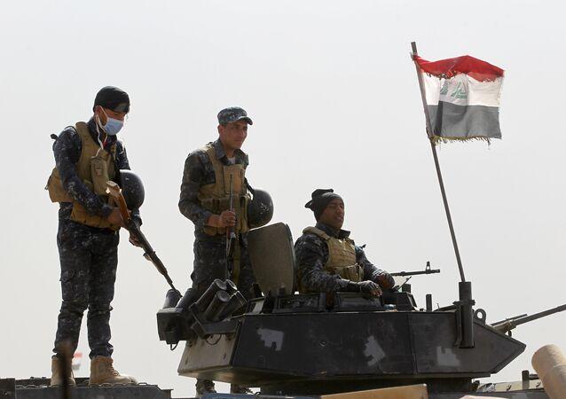 Forças iraquianas tomam posição na região de al-Shurah, Iraque, 17 de outubro de 2016