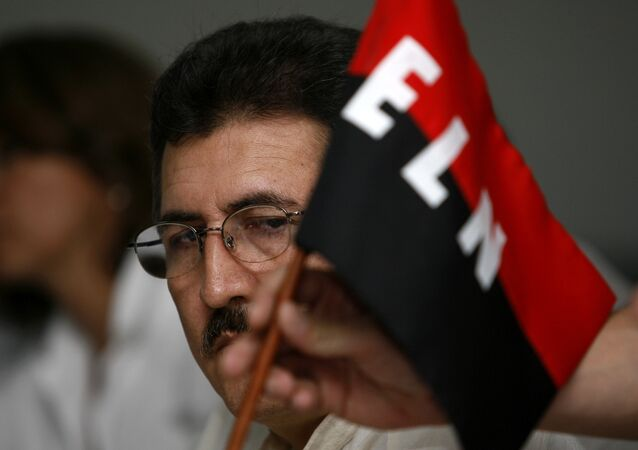 Antonio Garcia, leader of the National Liberation Army (ELN),looks at his rebel group's flag during a press conference at the Palco hotel in Havana