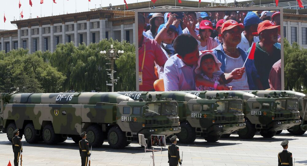 Military vehicles carry DF-16 short-range ballistic missiles during a parade commemorating the 70th anniversary of Japan's surrender during World War II held in front of Tiananmen Gate in Beijing, Thursday, Sept. 3, 2015. The PLA Rocket Force has tested the D-16 missiles in recent weeks.
