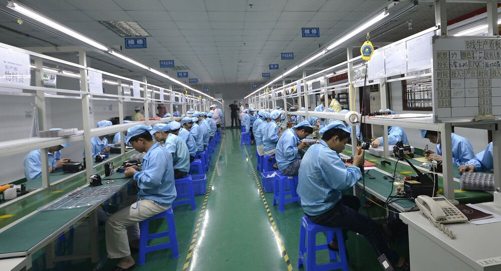 Trabalhadores de uma indústria na China.