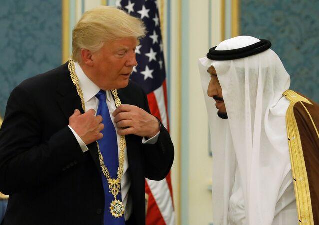 Saudi Arabia's King Salman bin Abdulaziz Al Saud (R) presents U.S. President Donald Trump with the Collar of Abdulaziz Al Saud Medal at the Royal Court in Riyadh, Saudi Arabia May 20, 2017