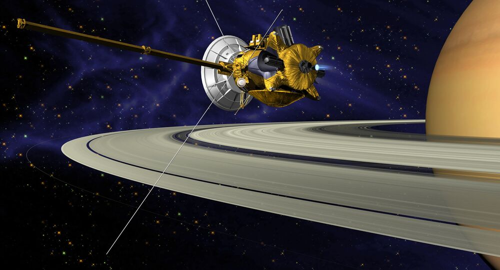 Imagem artística da sonda espacial Cassini perto de Saturno