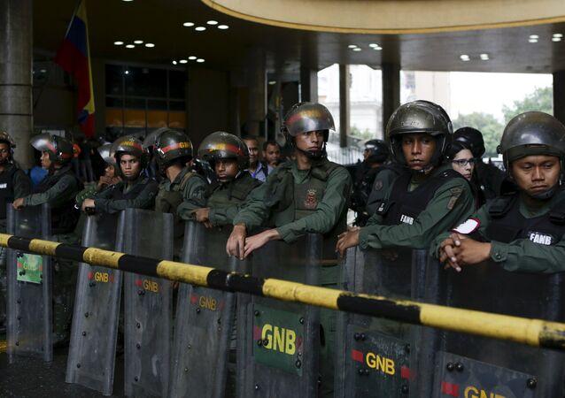 Venezuela's National Guards stand guard at the National Electoral Council (CNE) headquarters in Caracas, Venezuela, April 21, 2016.