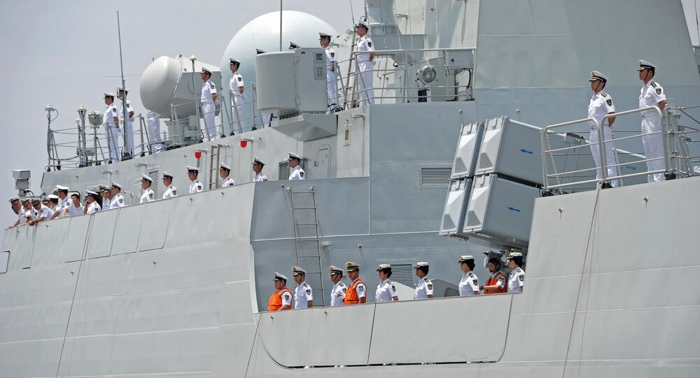 Crew members of Chinese Navy stand guard on the deck of Chinese navy ship Wei Fang
